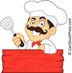 Chef sosteniendo espátula