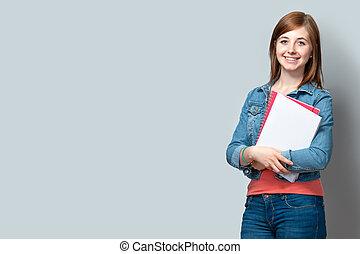 Chica adolescente con libros