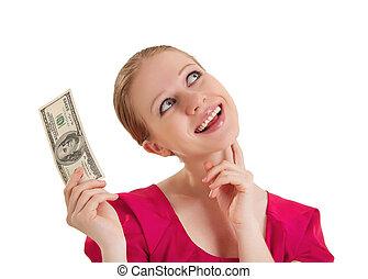 Chica alegre y soñadora con una blusa roja tiene el dinero, dólares americanos aislados en un fondo blanco