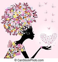Chica con una tarjeta de San Valentín de mariposas