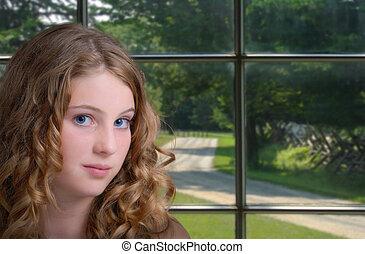 Chica por ventana