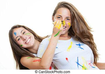 Chicas adolescentes con pintura
