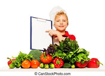 Chico en uniforme de cocinero con menú