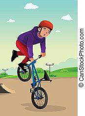Chico haciendo un truco de bicicleta