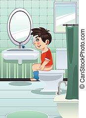 Chico sentado en el baño en el baño