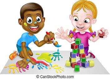 Chico y chica jugando con pinturas y bloques