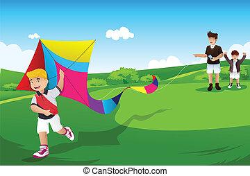 Chicos volando cometa con su padre