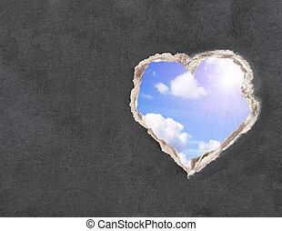Cielo azul con nubes y sol brillante en un papel de agujero