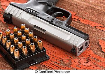 Cierra una pistola y un estante de municiones