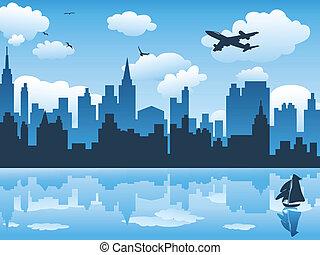 Ciudad en el cielo azul y su reflejo en el agua