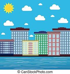 Ciudad junto al mar en un día soleado