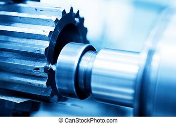 CNC girando, perforación y máquina aburrida en el primer plano del trabajo