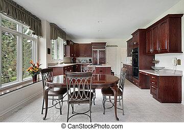 Cocina con armarios de madera de cereza