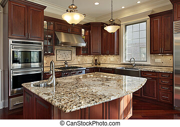 Cocina con isla de granito