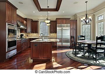 Cocina lujosa con armarios de madera de cereza