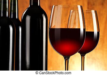 Composición con dos vasos de vino y botellas de vino tinto
