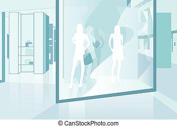 Comprando ventana moderna tienda de lujo en el centro comercial