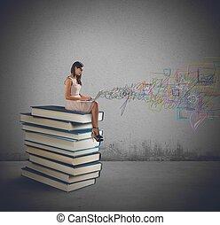 computador portatil, libros