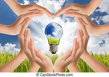 concepto, ahorro, luz, energía, global, planeta, brillante, verde, soluciones, manos, bombilla, paisaje