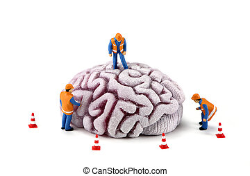 Concepto: obreros de la construcción inspeccionando el cerebro