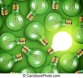 Concepto por una gran idea. Una bombilla brillante de fondo verde