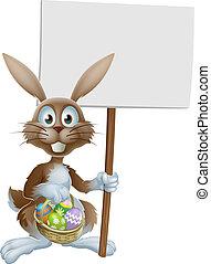 Conejo de Pascua con signo y huevos