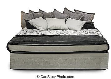 Confortable cama doble en un fondo blanco.