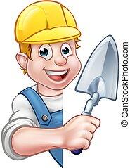 Constructor de ladrillos sosteniendo herramienta de la paleta