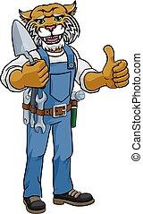 Constructor de ladrillos Wildcat sosteniendo herramientas de trowel
