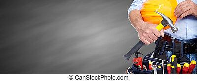 Constructor manitas con herramientas de construcción.