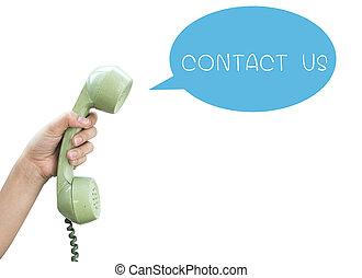 Contáctanos. Un teléfono vintage aislado en un backgr blanco