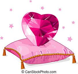 Corazón de amor en la almohada rosa