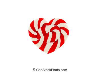 Corazón de caramelo rojo sobre fondo blanco
