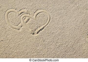 Corazones y arena