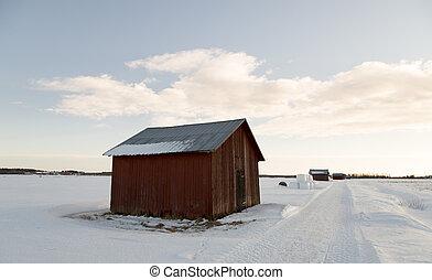 Corral en el campo de invierno;