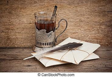 correo, taza, té, sobres