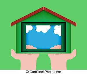 Cortado de papel en forma de casa. La idea de la construcción ecológica.