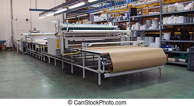 Cortando automáticamente la telaraña textil
