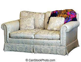 Couch con almohadón con alfombra colorida