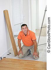 Craftsman cambiando el parqué