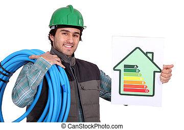 Craftsman trabajando en la economía energética del edificio