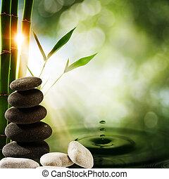 Curiosos ecológicos orientales con bambú y agua salpicadas