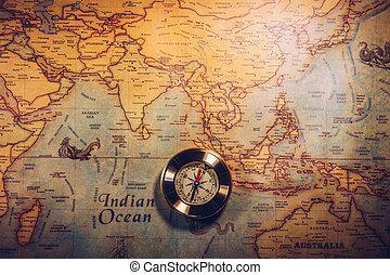 Día de Colón y mapa mundial con brújula