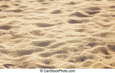 De la playa de arena