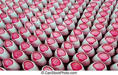 Desodorante, botellas con tapas rosas seguidas.
