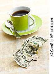 Dinero americano y taza de café