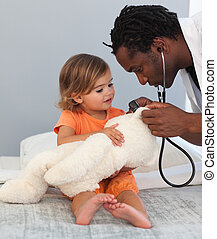 Doctor con un niño en un hospital