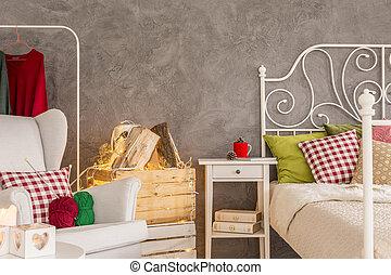 Dormitorio con cómodo sillón