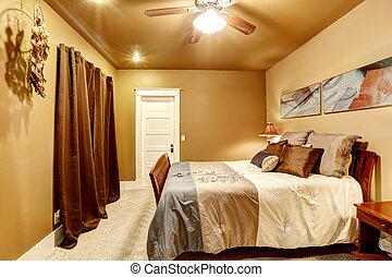 Dormitorio de tonos calientes con una cama hermosa