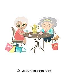 Dos ancianas hablando en un café después de las compras